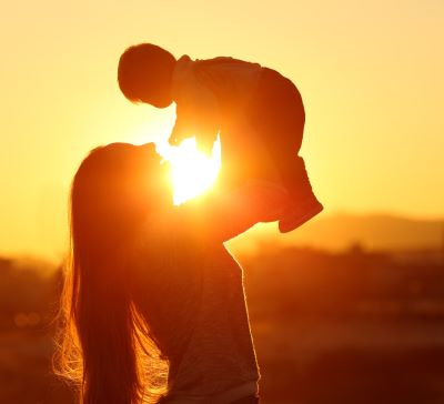 Mom and baby during sunset