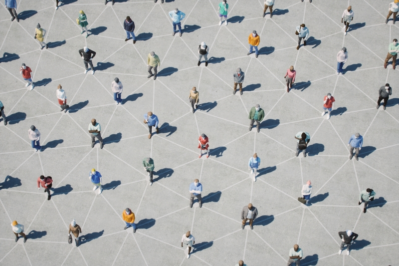 A group of people distancing themselves with a pattern of lines underneath them